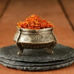Saffron spice in metal bowl macro shot soft focus